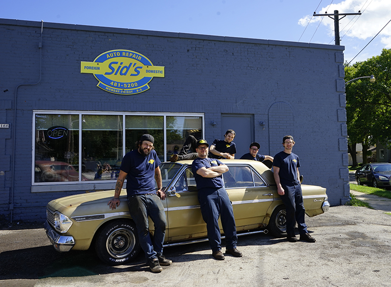 Sid's Auto's team of auto mechanics standing outside the garage.